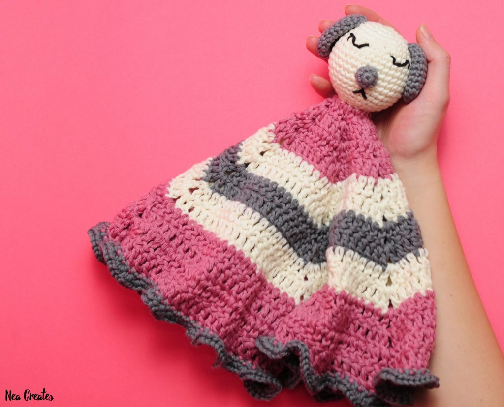 Crochet a super cute Sleepy Puppy Lovey using this free crochet pattern by Nea Creates! The pattern is easy and works up quickly! #freecrochetpattern | Nea Creates
