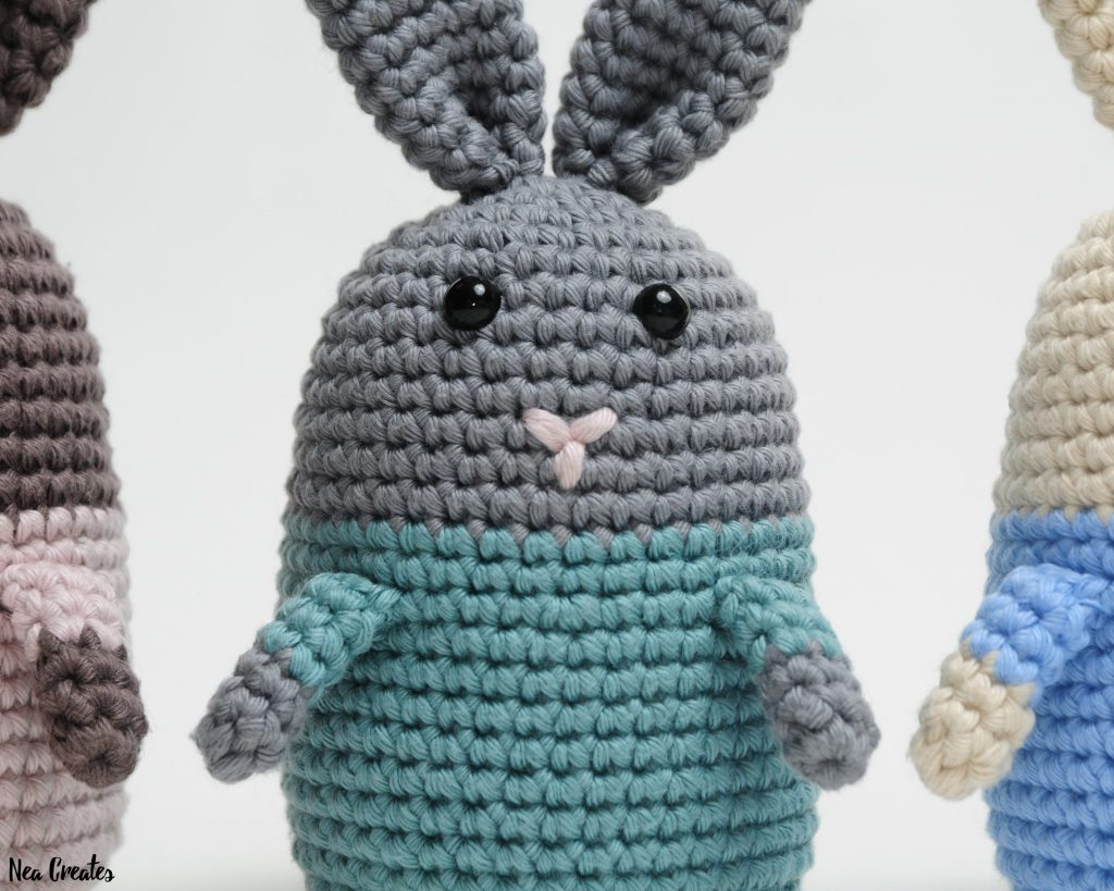 Crochet Emma the Easter Bunny using this FREE amigurumi pattern! Easy written pattern with photos. #freecrochetpattern #freeamigurumipattern #crochetpattern | Nea Creates