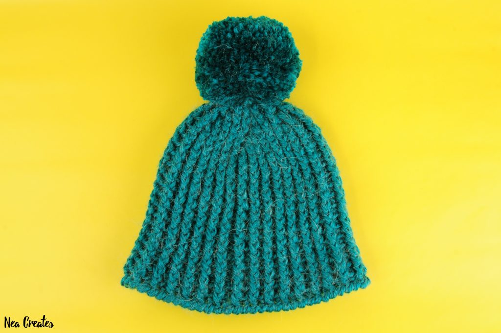 Learn how to crochet this gorgeous and warm Ribbed Winter Hat by following this FREE crochet pattern! | Nea Creates